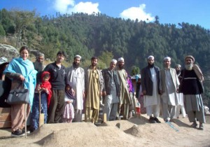 Dr. Omar Elahi and his team in the mountains with an affected family.