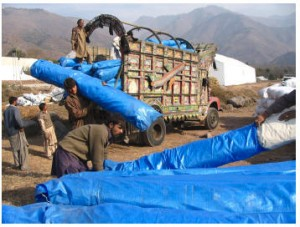 Winterized tents are unloaded from one of 26 trucks used to transport tents to Muzzaffarabad for distribution by CMAT staff.