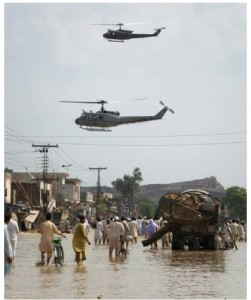Army helicopters look to distribute relief supplies from the air to the residents of Nowshera. (Adrees Latif/Reuters - courtesy CBC.ca)