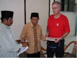 CMAT Team Leader Gerry Schrimer donates funds to mosque officials in Banda Aceh, collected from 7 families with the Muslim Association of Hamilton, in Hamilton, Ontario, Canada for Kurbani (distribution of meat to feed needy families on the occasion of the Muslim Hajj or Pilgrimage).