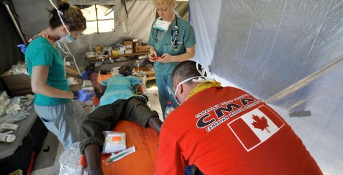 CMAT volunteers provide medical aid in a field hospital in Leogane, Haiti. January 2010.