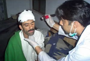 Dr. Omar Elahi from CMAT Team 2 treating a patient.