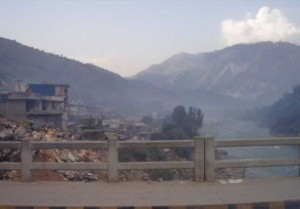 A photo of the destruction in the city of Muzaffarabad from the main bridge over the river Neelum.