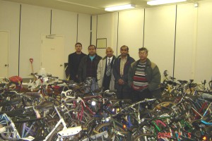 Organizers amidst 250 donated bicycles from McMaster University faculty and students.