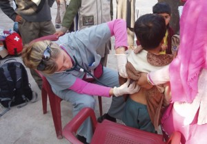Dr. Lynda Redwood-Campbell assessing a child in a village near Muzaffarabad.