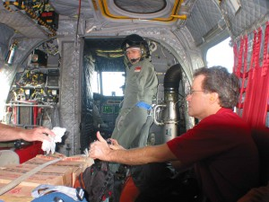 CMAT Volunteer Dr. Kirk Sundby, Orthopedic Surgeon sits on Singapore Air Force Chinook helicopter with rest of CMAT team enroute to Medan. (January, 2005