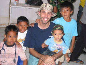 CMAT team member Mr. Bill Coltart, from Comox, B.C. poses with child survivors of Tsnunami in Meuloboh, Indonesia. (January 2005)