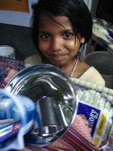 "A young girl receives a hygiene ""life"" kit at Sirumalar Home for Children in Tamil Nadu, India."