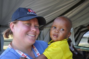 Canadian Medical Assistance Teams executive director and RN Valerie Rzepka shares some smiles with a young patient she helped in Leogane, Haiti.