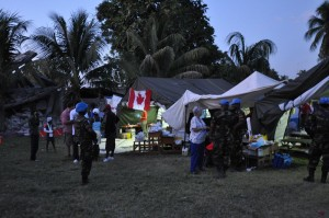 UN Peacekeepers visit CMAT volunteer staff at  dusk in their field hospital in Leogane, Haiti. January 2010.