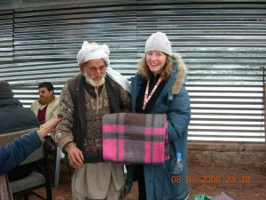 CMAT Canadian volunteers begin the distribution of thermal blankets.