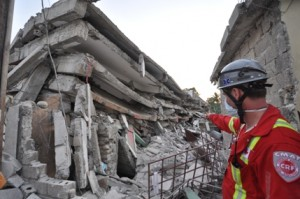 CMAT Paramedic Ryan Thorburn assesses the earthquake damage in some of the buildings in Port au Prince, Haiti.