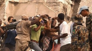 People carry an injured person in Port-au-Prince after the largest earthquake ever recorded in the area rocked Haiti on Tuesday. (Radio Tele Ginen/ Associated Press)