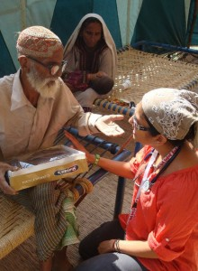CMAT Volunteer Dr.  Samina Ali has a discussion with an elder in Sukkur.