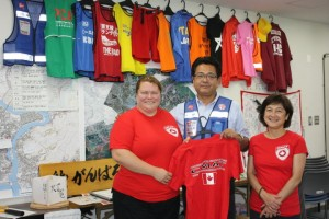 Valerie Rzepka and Seiko Watanabe present a CMAT shirt to the IDRAC Chairman to add to the display.