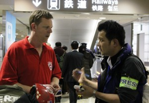 CMAT Team Leader Dave Johnson meets with media at Tokyo's Narita airport.