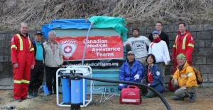 CMAT paramedic Martin Metz and OT Seiko Watanabe install a Nomad water purification system in the town of Aikawa Kitakamicho.