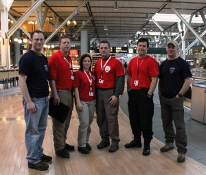 CMAT and IMAT Rapid Assessment Team checking in at YVR. L-R: Ian Burkheimer (IMAT), Dave Johnson (CMAT Team Leader), Kelly Kaley (CMAT), Kevin Sanford (CMAT), Ryan Thorburn (CMAT), Brett Martinson (IMAT).