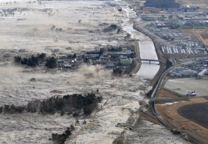 The quake unleashed a tsunami that swept boats, cars, buildings and tonnes of debris kilometres inland. Here the tsunami strikes shores along Iwanuma. (Photo courtesy Kyodo News/AP)