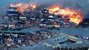 Houses swept out to sea burn in the aftermath of the quake. (Photo courtesy CNN.com)