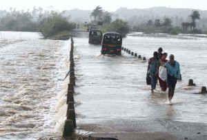 People in Odisha, India wade through flooded roads in the wake of Cyclone Phallin.