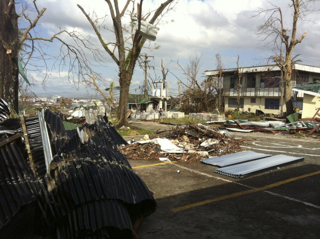 The wrath of Typhoon Yolanda (Haiyan) is evident on the buildings of Ormoc.  Roof sheets torn off by the wind are wrapped around trees.