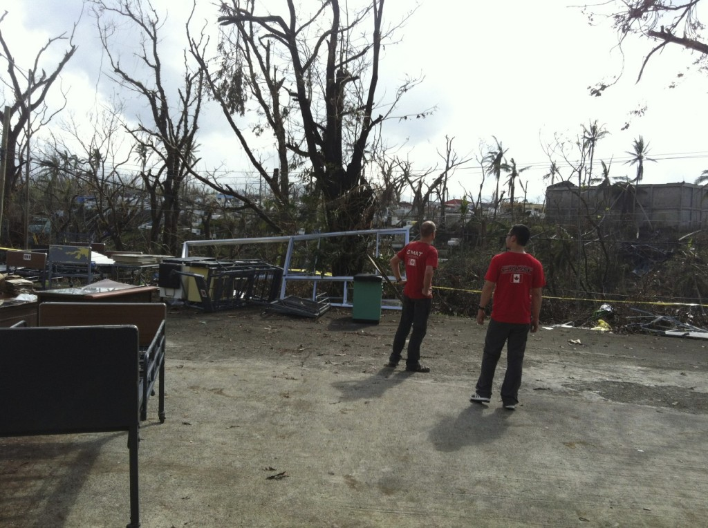 CMAT Assessment Team members Martin Metz and Marty Quintia assess the infrastructure damage in Ormoc, Leyte.
