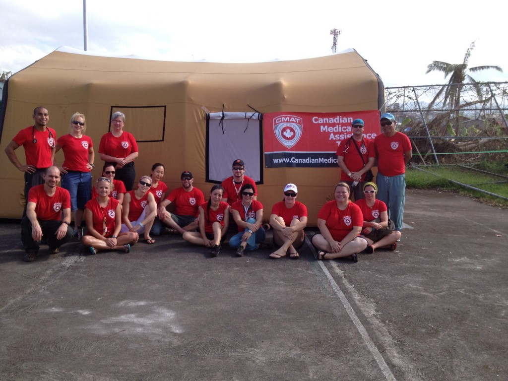 CMAT Team Members gather in front of the field hospital tent in Ormoc City, Leyte.