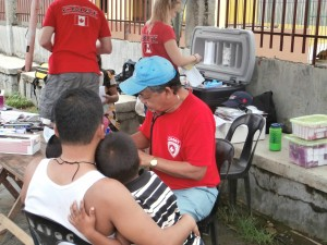 Dr. Rene Bolzos treats a patient during a mobile clinic in Leyte, Philippines.