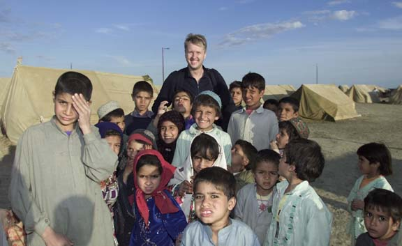 CMAT Volunteer Webmaster Mikael Kjellström with children in Afghanistan.
