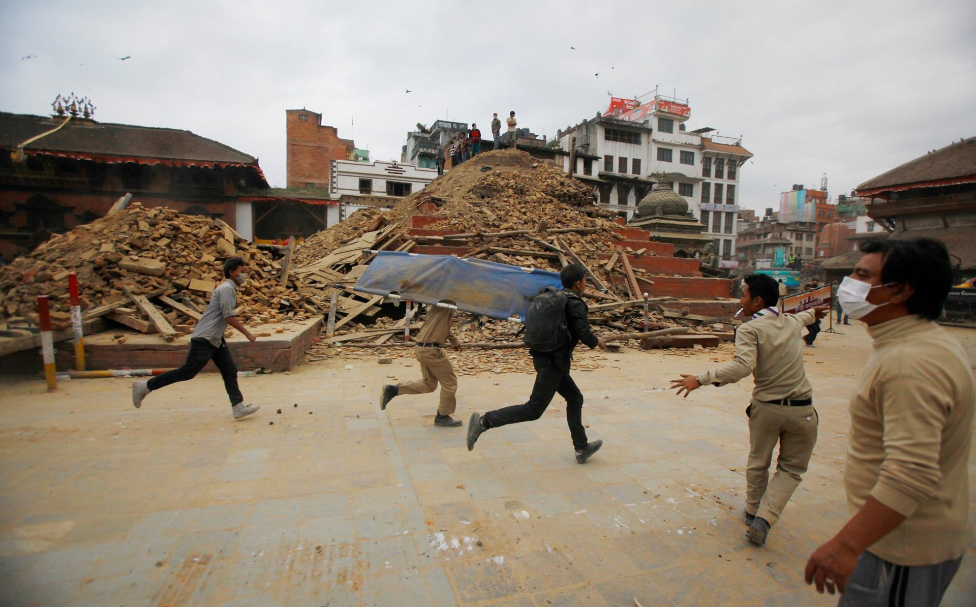 Rescuers rush to help victims of the devestating earthquake in Nepal - April 25, 2015