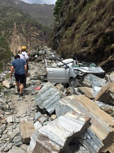 A car is crushed in a rockslide after a 7.9 magnitude earthquake struck Nepal April 25, 2015
