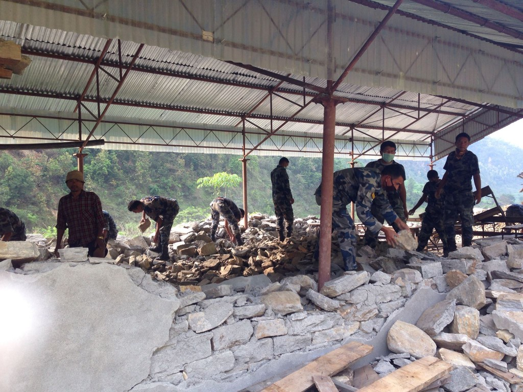 Nepali soldiers have arrived in Baluwa to help reconstruct the school adjacent to where CMAT team members are camping.