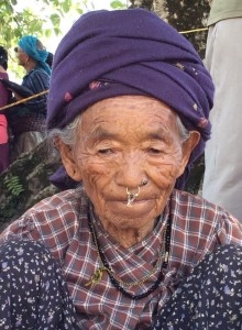 Elderly woman waiting to be assessed in the CMAT clinic in Takukot.