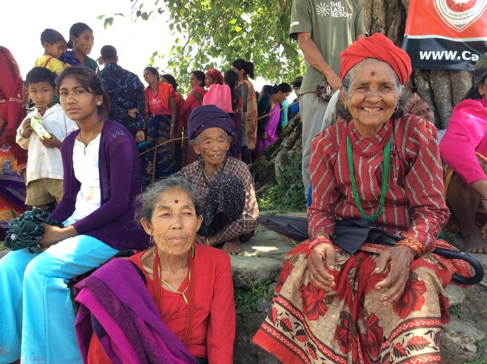 Women gather under a tree for shade, while waiting for their turn at the CMAT clinic in Takukot, Nepal